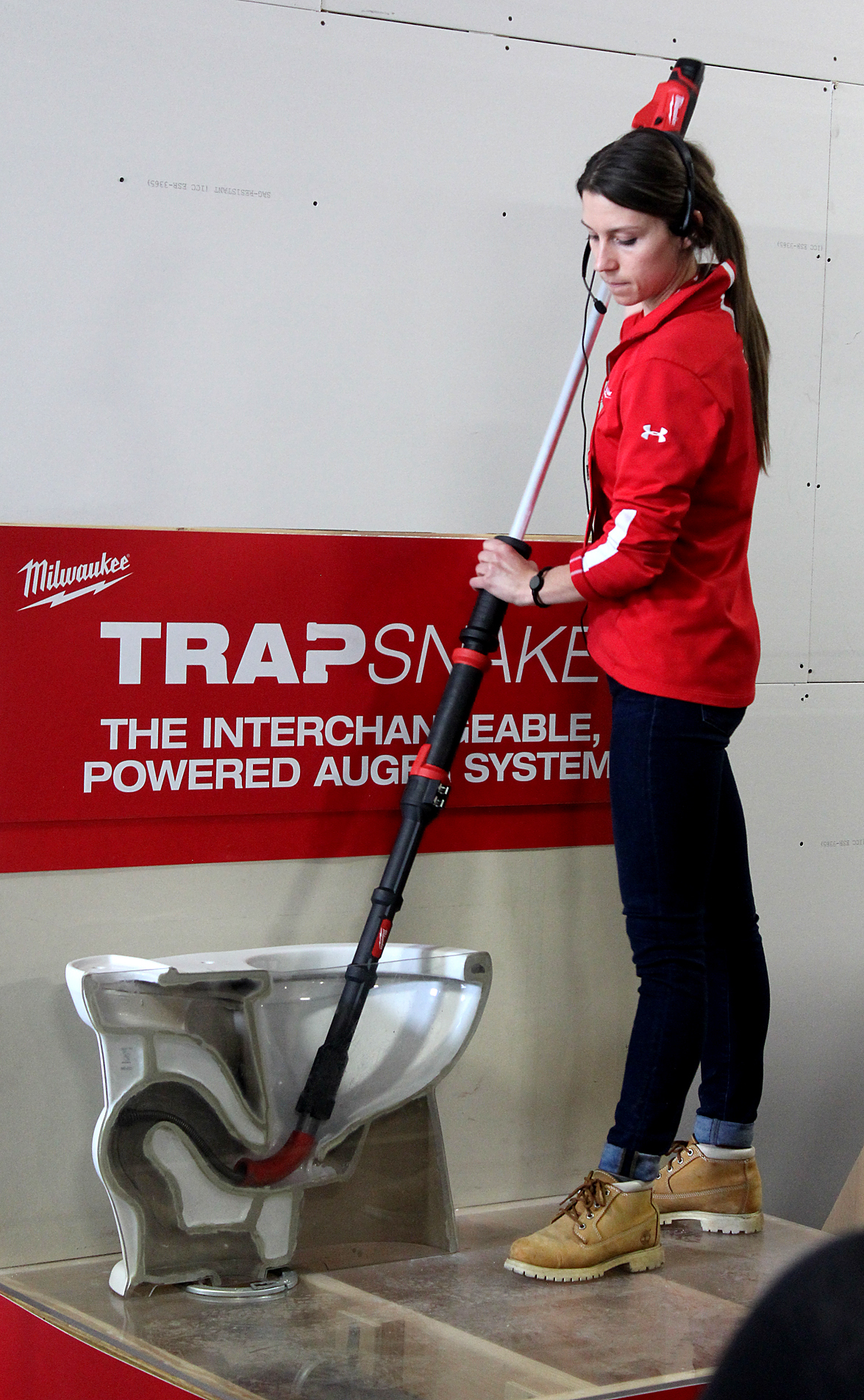 A Milwaukee Tool representative demonstrates the TrapSnake tool released earlier this year, designed for plumbers and drain cleaners.