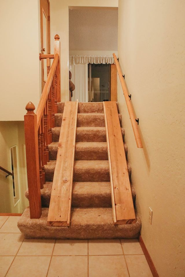 Before the remodel courtesy of the Pay It Forward program, Henry Mandler was using 2x6s to get up and down stairs in his wheelchair. (Photo courtesy of T 'N G Plumbing)