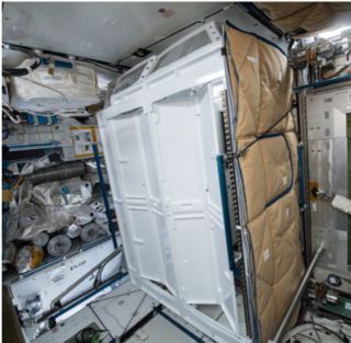 For privacy, the toilets on the ISS are located in stalls similar to their earthbound counterparts.