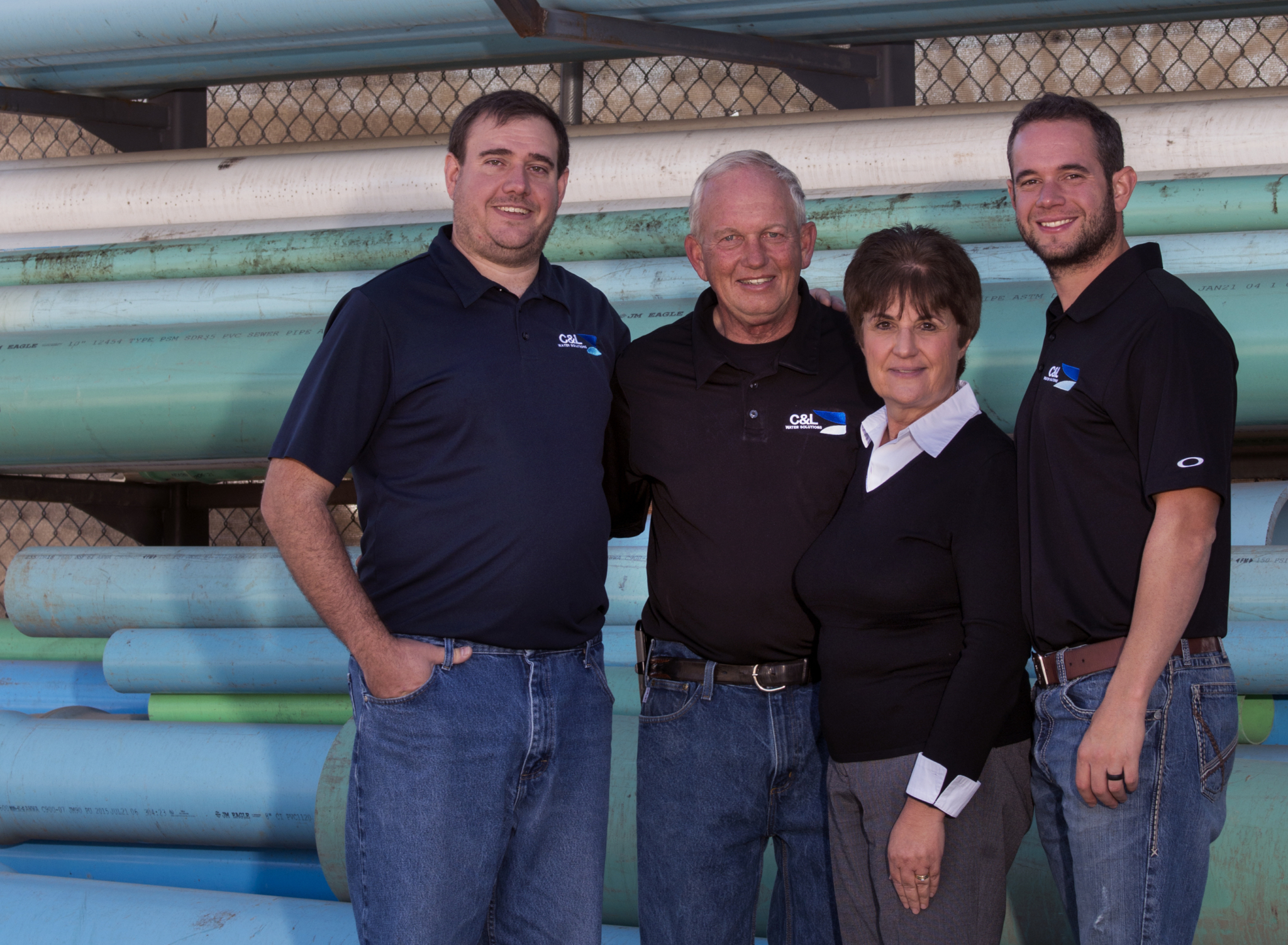 Larry and Chrystalla Larson (middle), founders of C&L Water Solutions in Littleton, Colorado, alongside sons Jason and Chris, who now run the company.